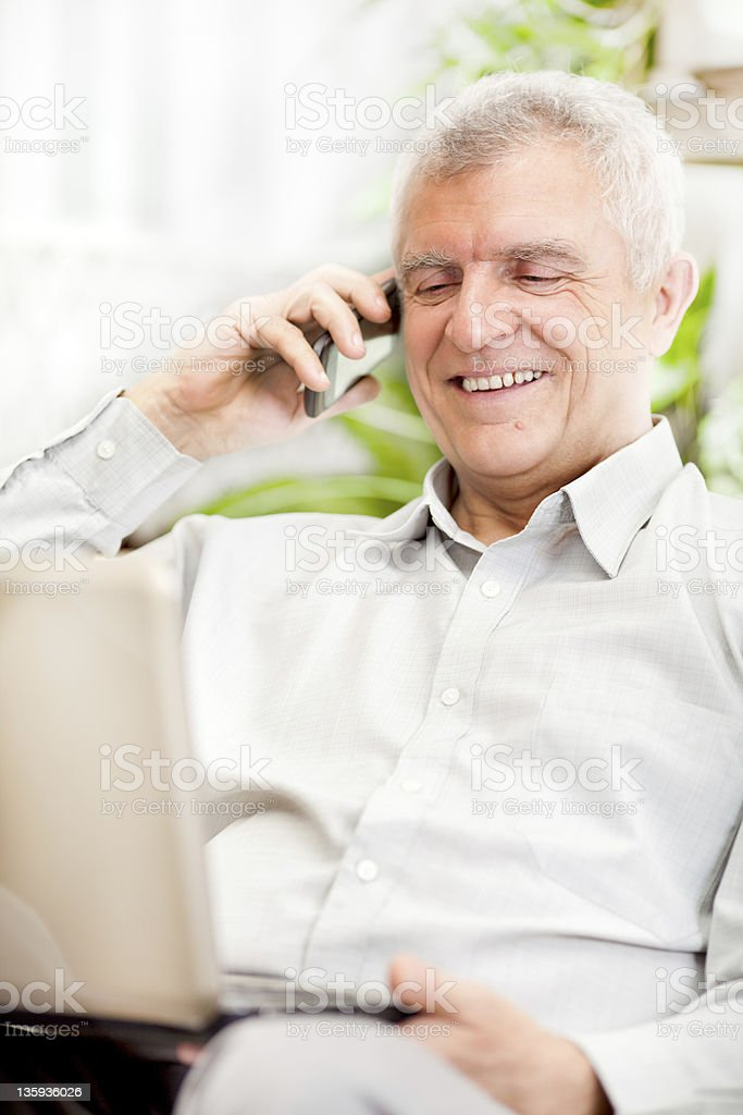 Senior businessman working at home royalty-free stock photo