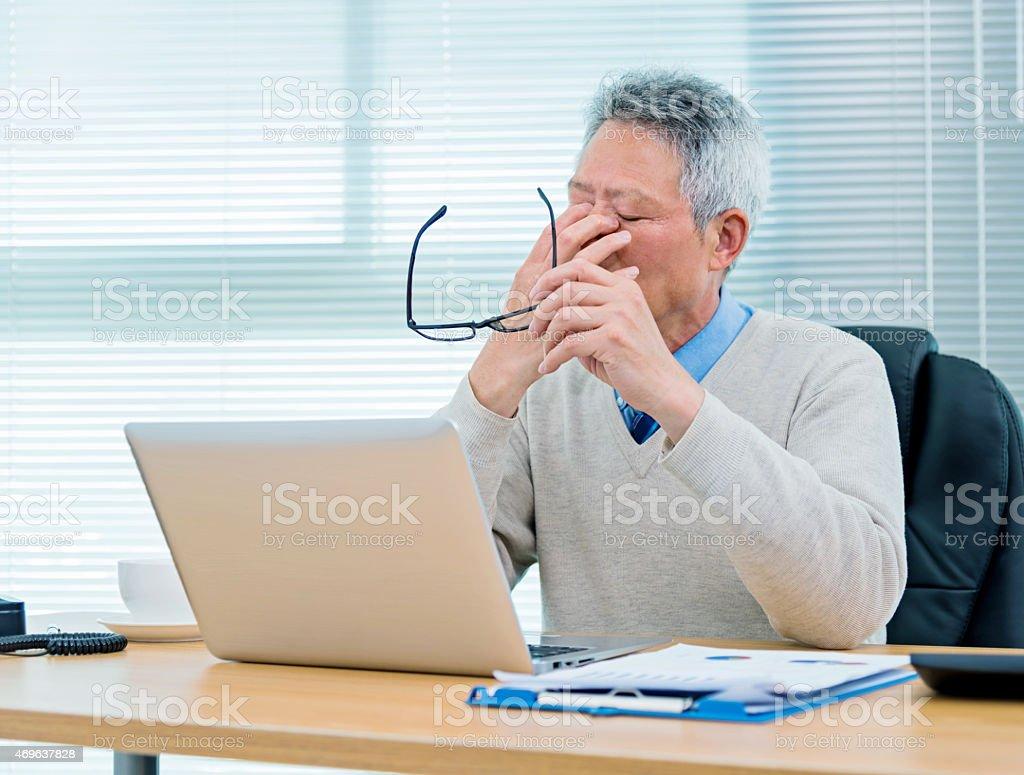 Senior businessman working stock photo