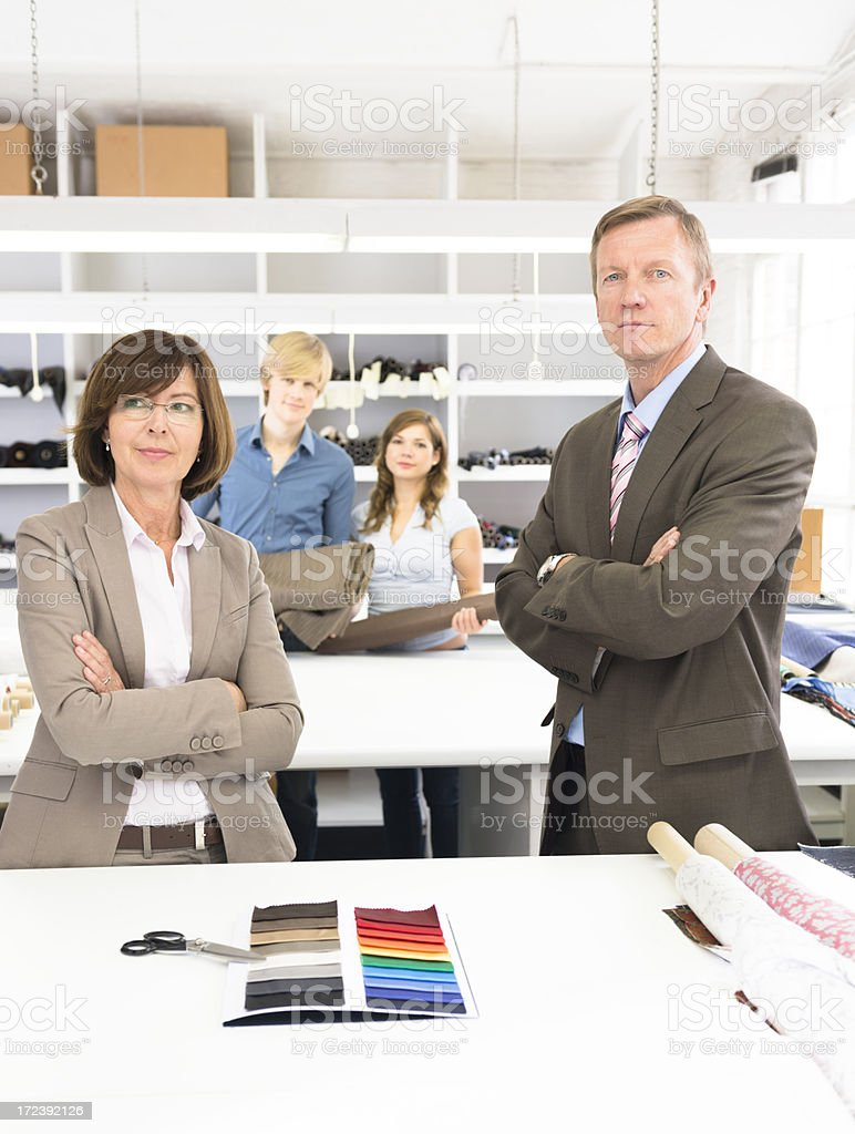 Senior businesswoman boss portraitwith her team royalty-free stock photo