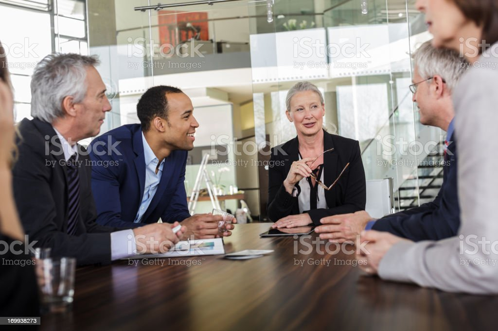 Senior Businesswoman leading a meeting royalty-free stock photo