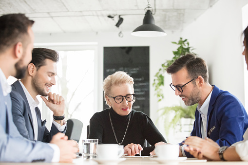 Senior Businesswoman Meeting With Team Stock Photo - Download Image Now