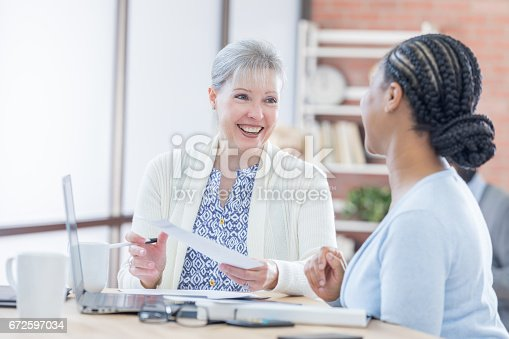 487670635istockphoto Senior businesswoman meets with colleague 672597034