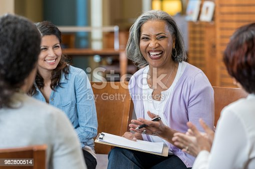 956725740istockphoto Senior businesswoman meets with colleagues 982800514