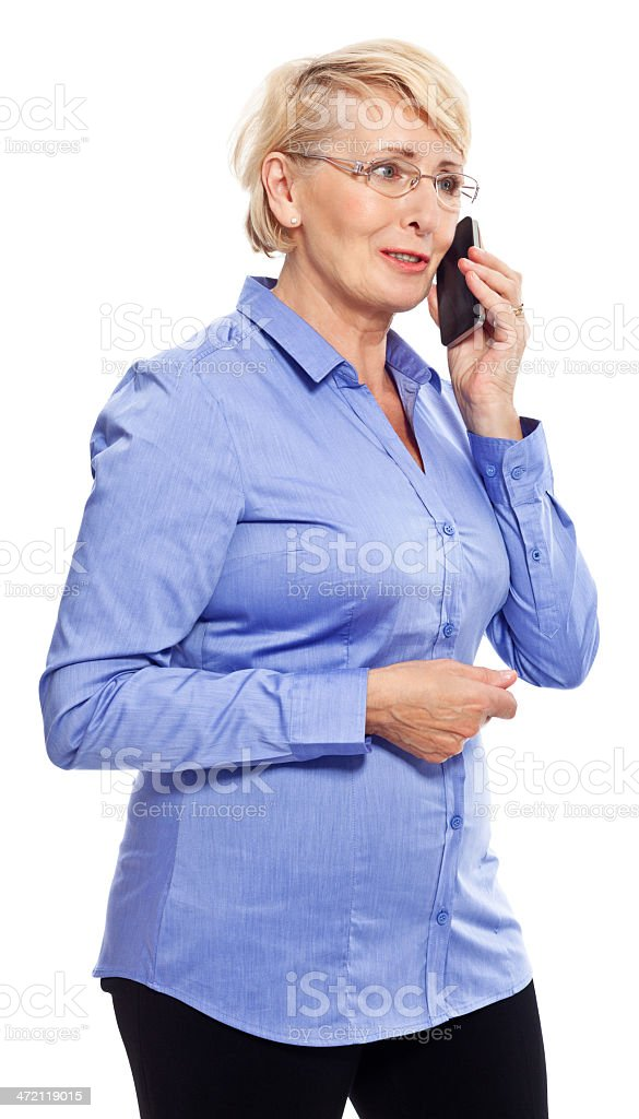 Senior businesswoman on the phone Portrait of senior businesswoman talking on smart phone. Studio shot, white background. 60-69 Years Stock Photo