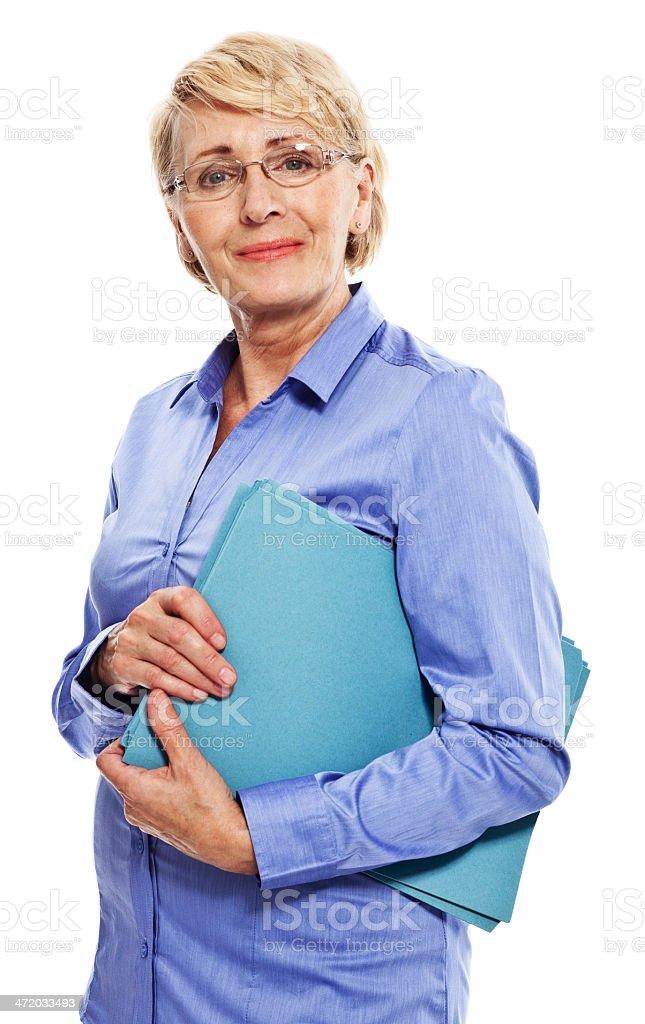 Senior businesswoman Portrait of confident senior businesswoman holding files and smiling at camera. Studio shot, white background. 60-69 Years Stock Photo