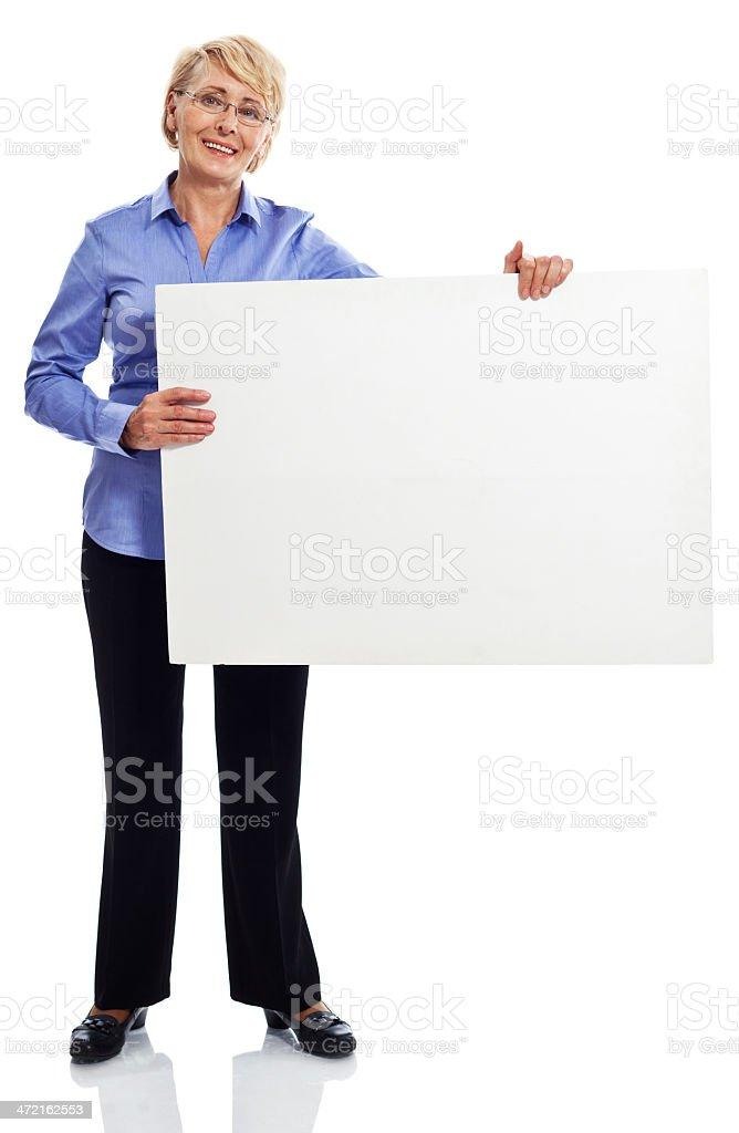 Senior businesswoman Full lenght portrait of confident senior businesswoman holding a whiteboard. Studio shot, white background. 60-69 Years Stock Photo