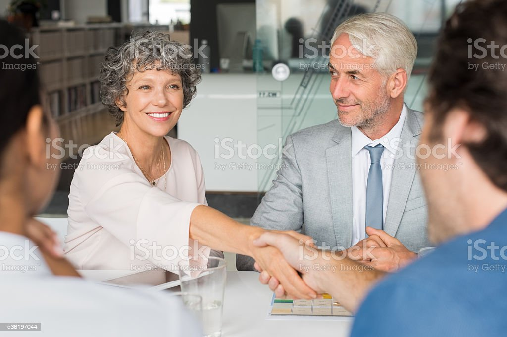 Senior businesswoman shaking hands stock photo