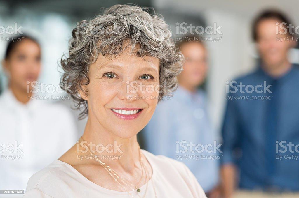 Senior businesswoman smiling stock photo