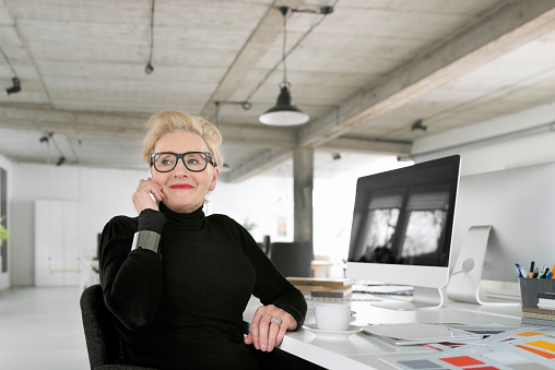 Senior Businesswoman Talking On Phone In The Office Stock Photo - Download Image Now