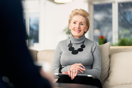 Senior Businesswoman Talking With Young Woman Stock Photo - Download Image Now