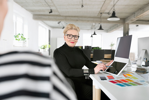 Senior Businesswoman Using A Digital Tablet In The Office Stock Photo - Download Image Now