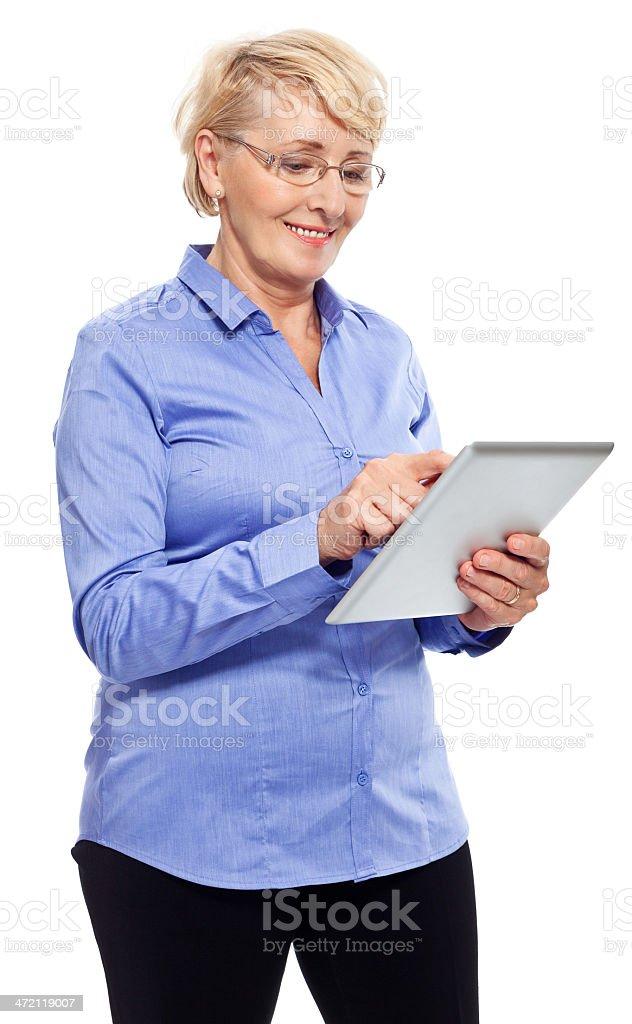 Senior businesswoman with digital tablet Portrait of smiling senior businesswoman using a digital tablet. Studio shot, white background. 60-69 Years Stock Photo