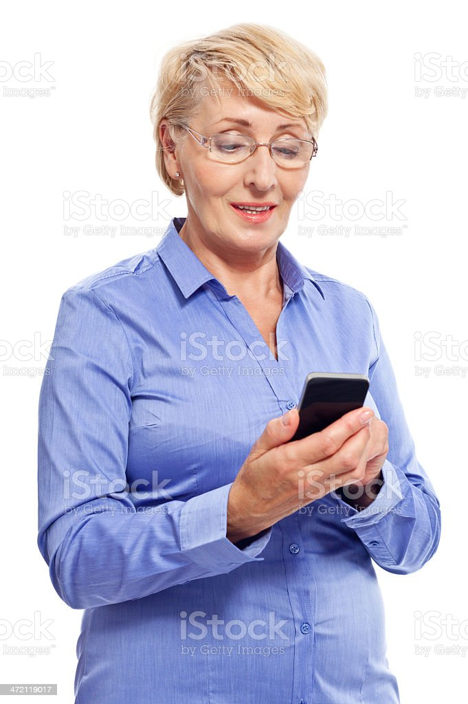 Senior businesswoman with smart phone Portrait of senior businesswoman using a smart phone. Studio shot, white background. 60-69 Years Stock Photo