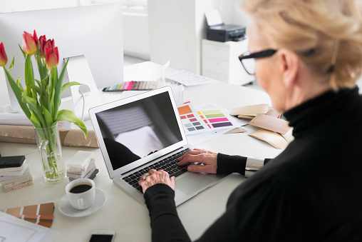 Senior Businesswoman Working On Laptop In The Office Stock Photo - Download Image Now