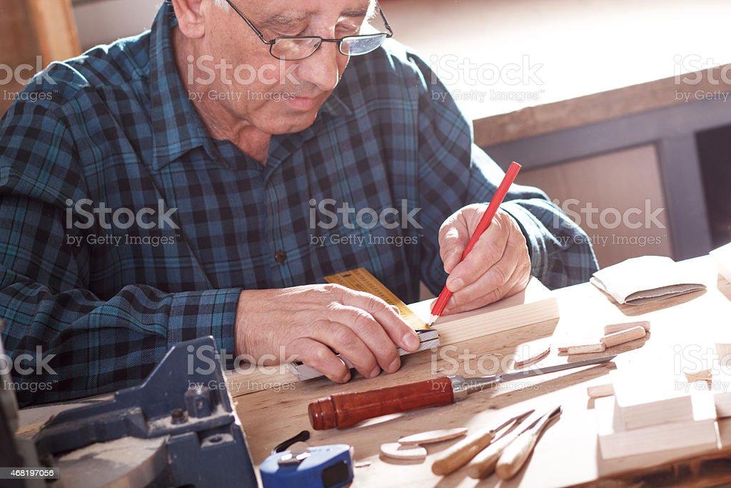 Senior carpenter working in workshop stock photo