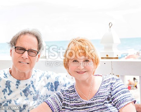452783143 istock photo Senior caucasian couple enjoy a day by the beach 472113900
