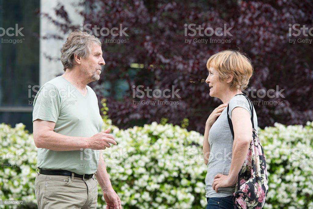 Senior caucasian couple talking outdoors in city park royalty-free stock photo