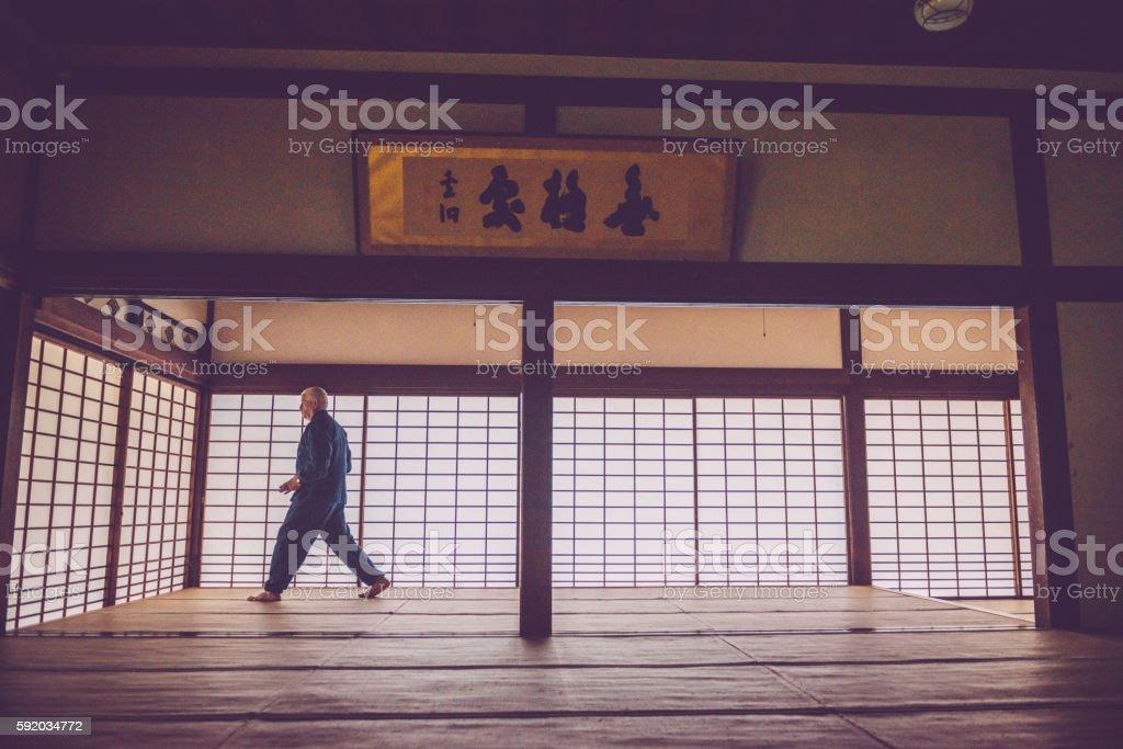 Senior Caucasian Man Exercising Karate in Buddhist Temple, Kyoto, Japan stock photo
