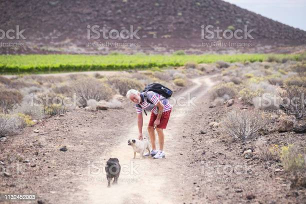 Senior caucasian man have fun and enjoy a trekking walk in a path picture id1132452003?b=1&k=6&m=1132452003&s=612x612&h=8uahd324qempee7npep5ticoeucqesdxcus7 pesvpo=
