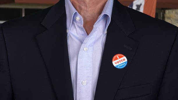 Senior caucasian man in formal clothing with Voted sticker stock photo