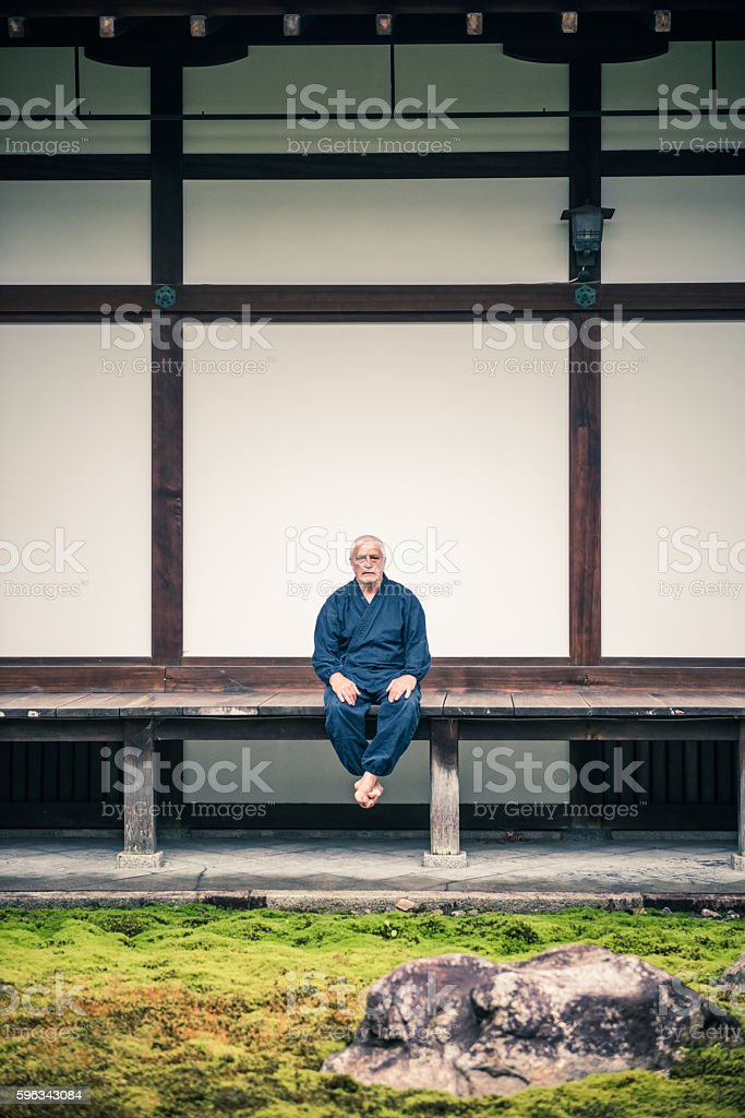 Senior Caucasian Man Meditating in Buddhist Temple, Kyoto, Japan royalty-free stock photo