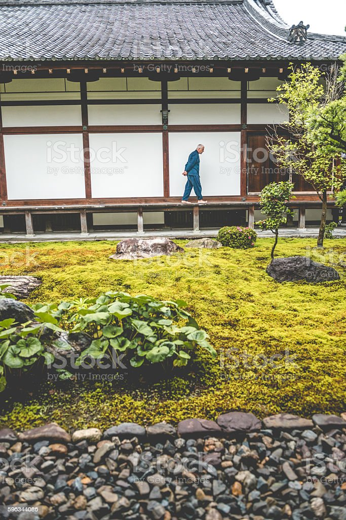 Senior Caucasian Man Walking in Buddhist Temple, Kyoto, Japan royalty-free stock photo