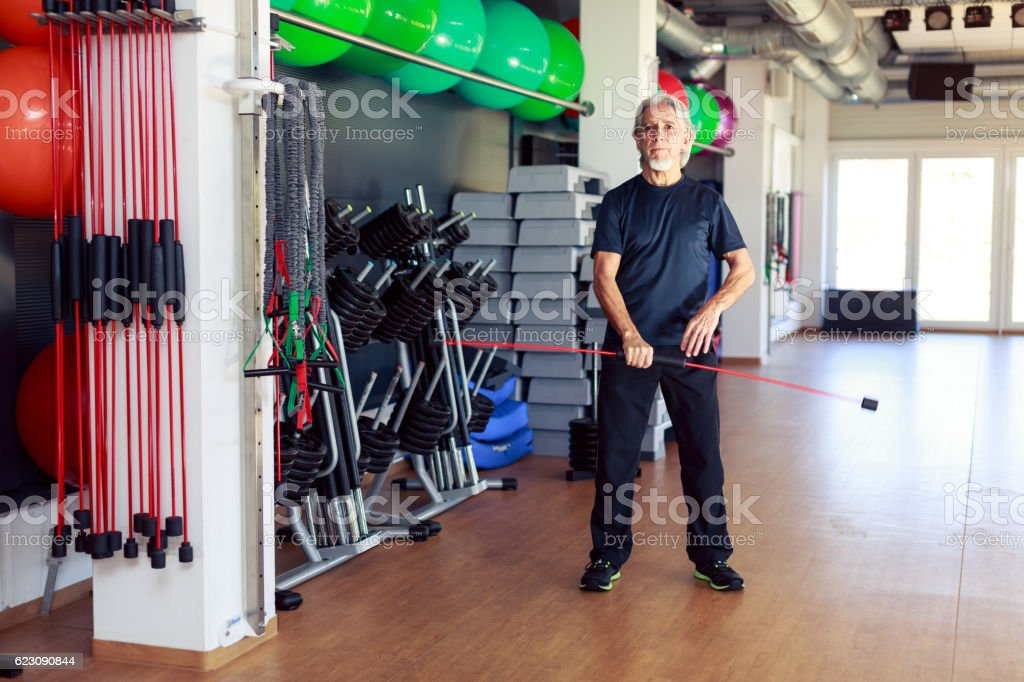 Senior Caucasian Man Working Out at the Gym stock photo