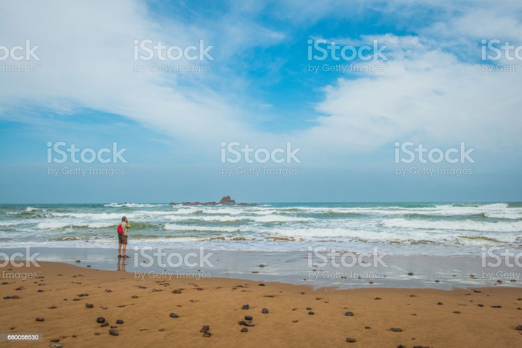 Senior Caucasian Tourist on Legzira Beach, Sidi Ifni, Morocco, Africa stock photo