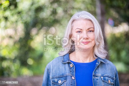 Portrait of a beautiful senior woman in nature