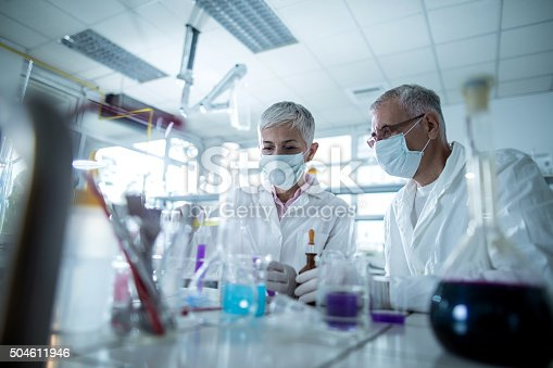 499203366istockphoto Senior chemists working on a new scientific experiment in laboratory. 504611946
