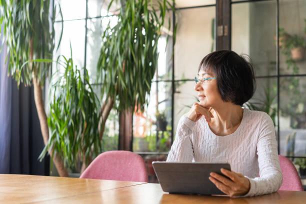 Senior Chinese woman at home stock photo