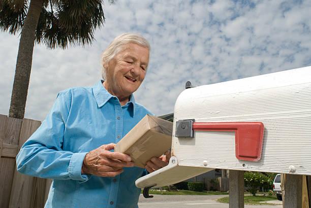 Senior Citizen at mailbox stock photo