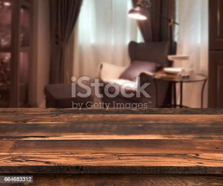 istock Senior citizen blur living room interior, wooden table in front 664683312