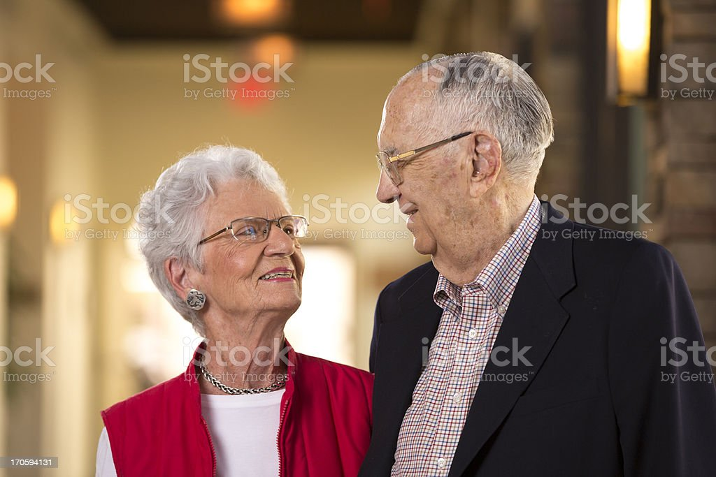 Senior citizen couple looking at each other royalty-free stock photo