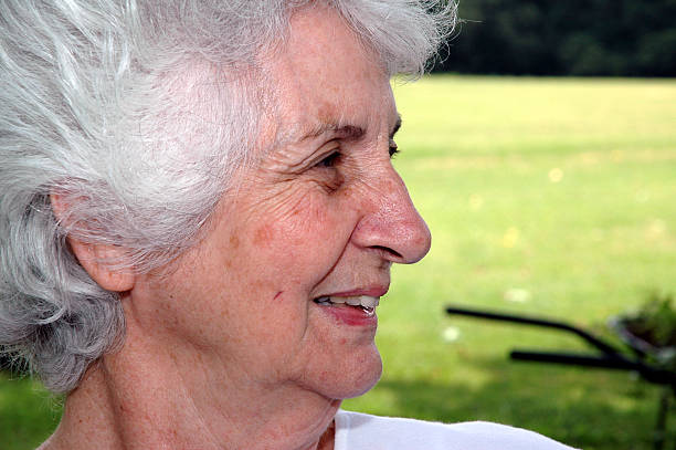 Senior Citizen - Face Profile of a gracefully aging woman. dark spots face stock pictures, royalty-free photos & images