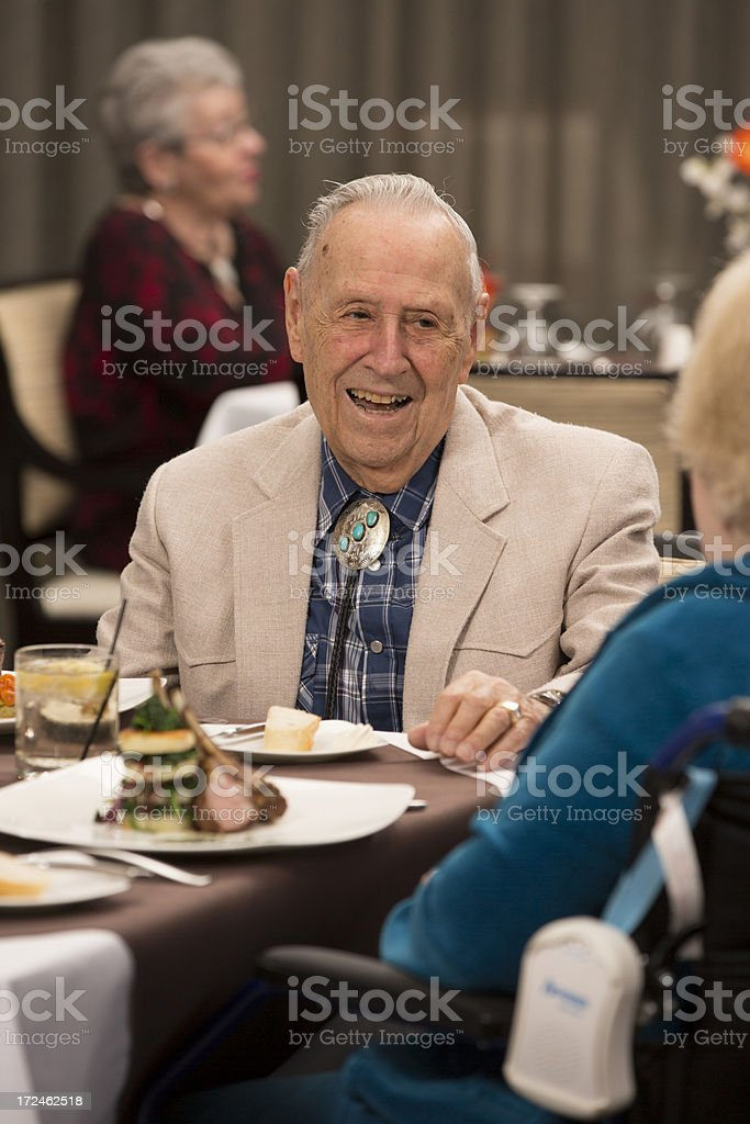 Senior Citizen man enjoying his dining experience royalty-free stock photo
