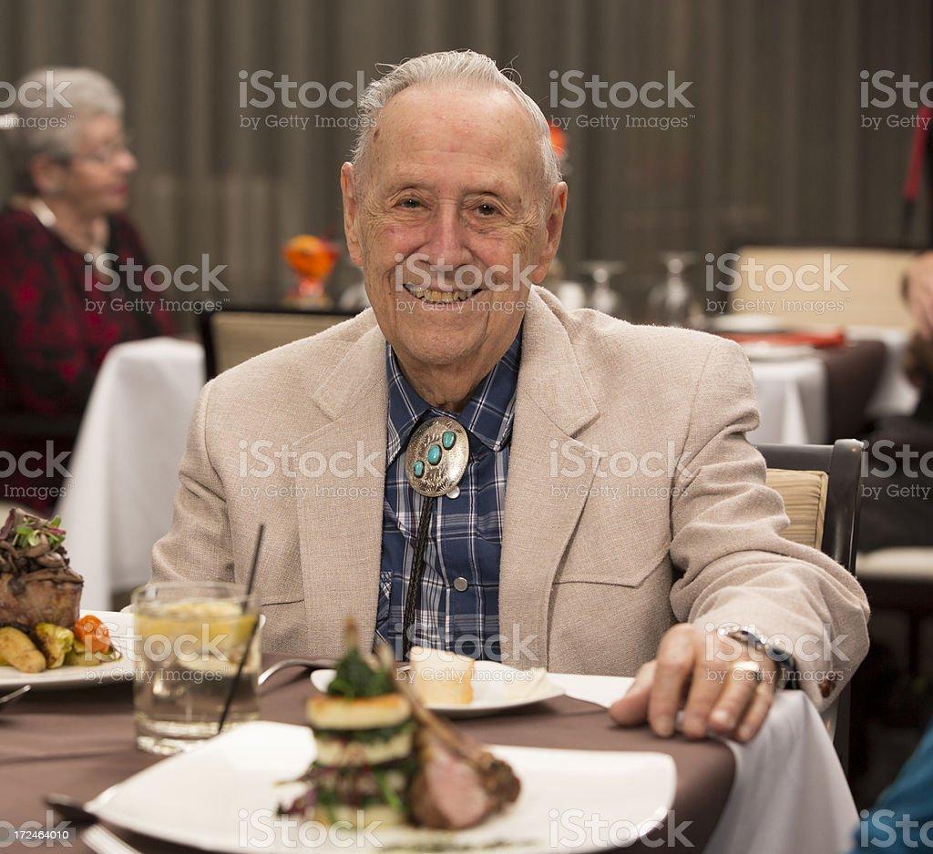 Senior Citizen man enjoying his dining experience royalty-free stock photo