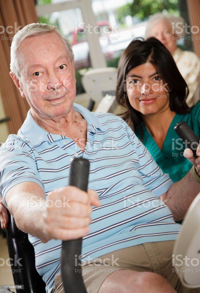 Senior Citizen Man Exercising with Nurse royalty-free stock photo