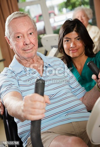 istock Senior Citizen Man Exercising with Nurse 157433768