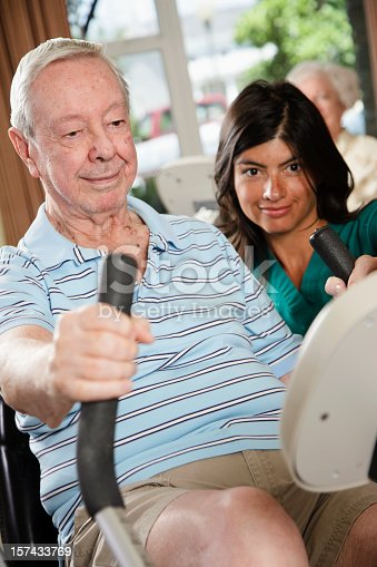 istock Senior Citizen Man Exercising with Nurse 157433769