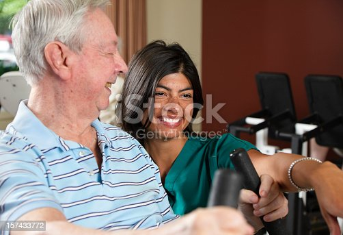 istock Senior Citizen Man Exercising with Nurse 157433772