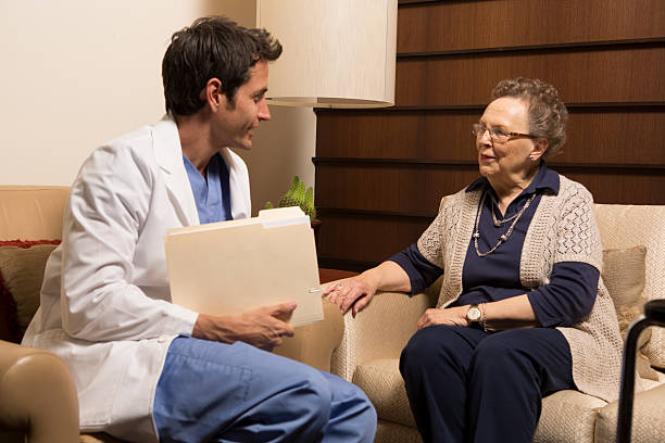 senior citizen meeting with doctor - question mark asking doctor nurse stock photos and pictures