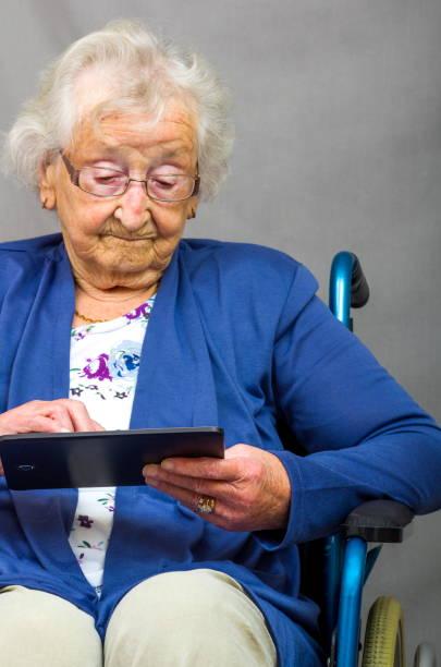 Senior Citizen using a Computer Tablet. stock photo