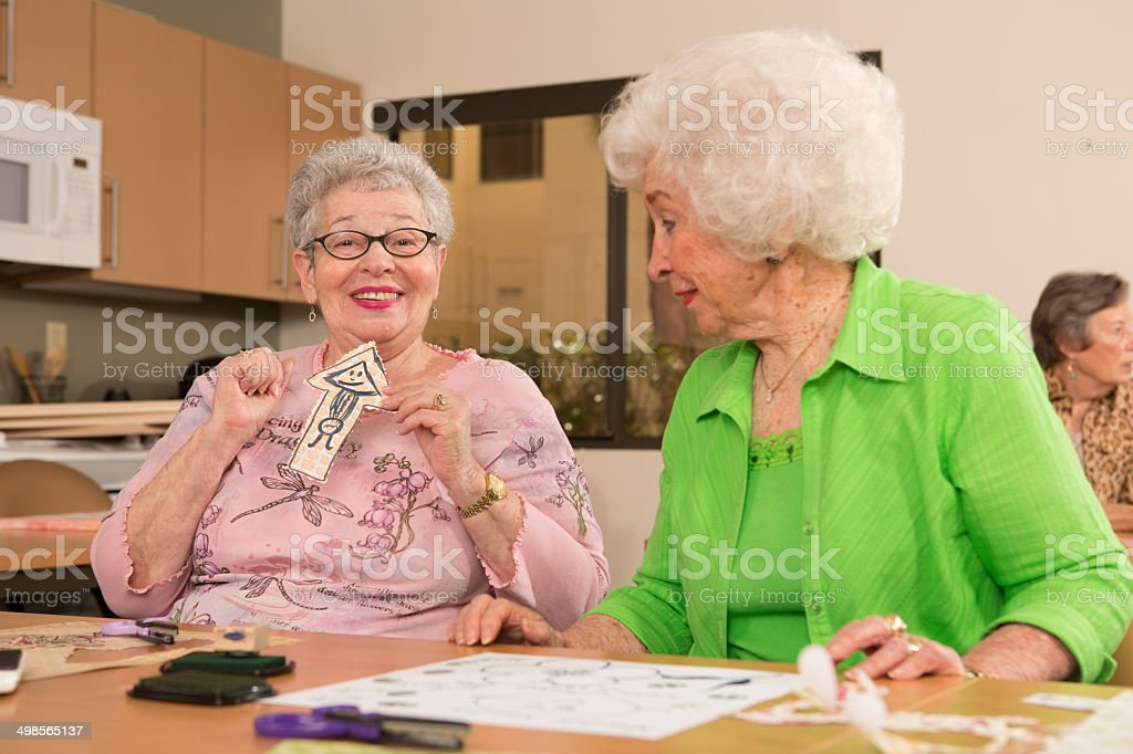 Senior Citizen woman doing arts and crafts, arrow stock photo