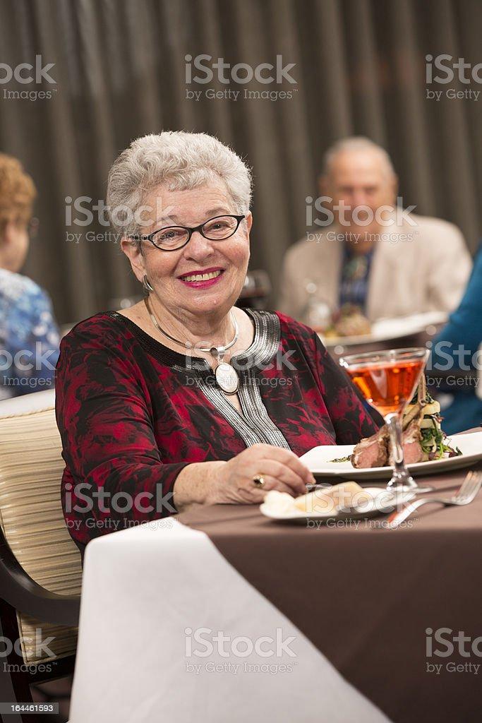 Senior Citizen woman enjoying her dining experience royalty-free stock photo