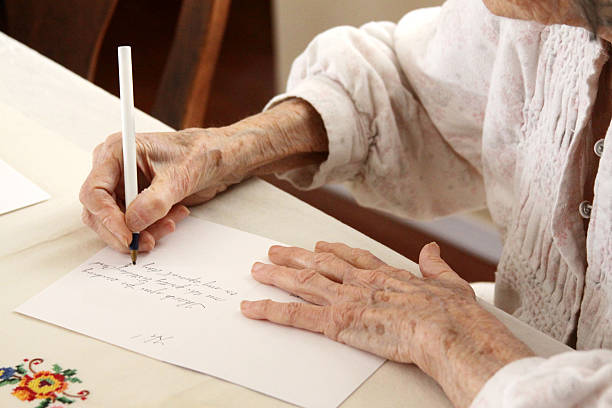 Senior Citizen Writing a Note stock photo