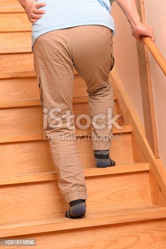181879982istockphoto Senior climbs up stairs 1091615896