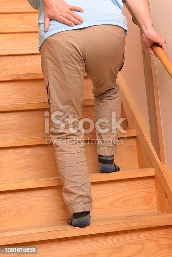 181879982istockphoto Senior climbs up stairs 1091615898