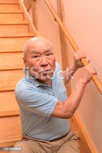 181879982istockphoto Senior climbs up stairs 1091615908