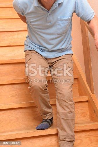181879982istockphoto Senior climbs up stairs 1091615922